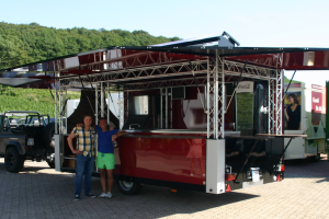 Our colleague Michael Bonefas is passing a cocktail concession van to Massimo Fard